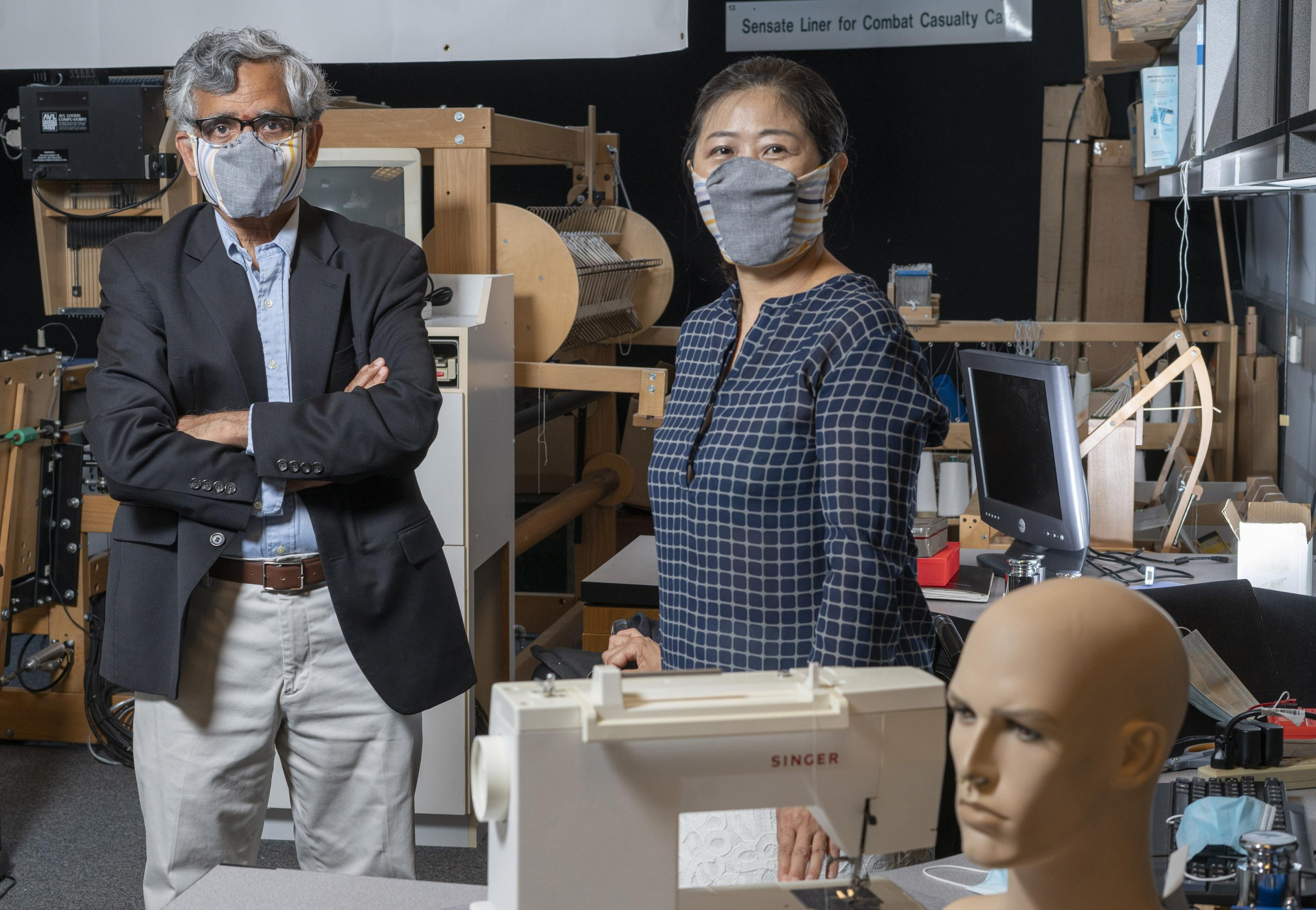 Georgia Tech professor Sundaresan Jayaraman and principal research scientist Sungmee Park wear prototypes of their redesigned face mask. (Credit: Christopher Moore, Georgia Tech).