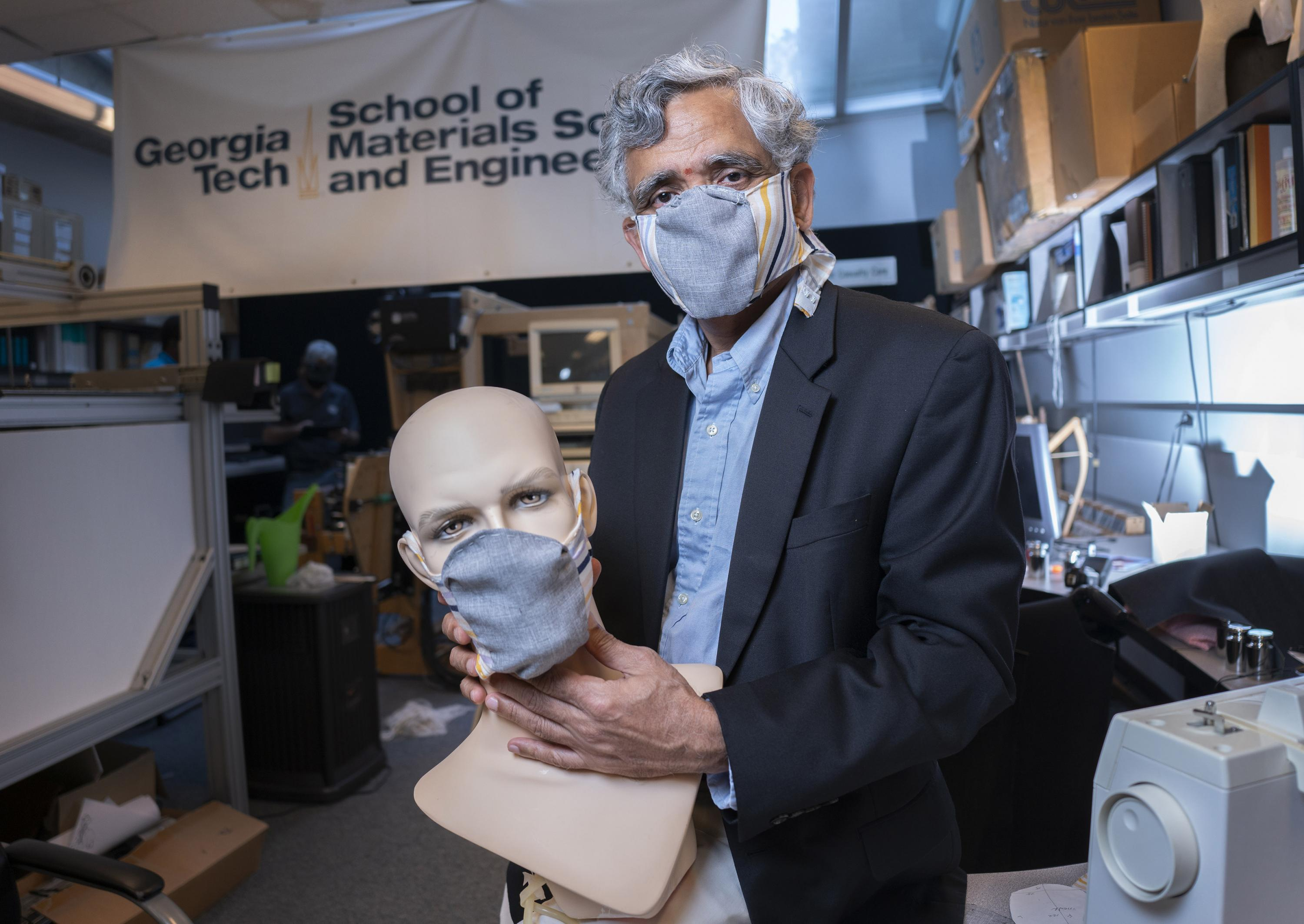 Georgia Tech professor Sundaresan Jayaraman with prototypes of the redesigned face mask. (Credit: Christopher Moore, Georgia Tech)