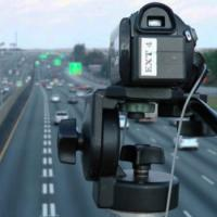 A video camera overlooks a freeway to survey traffic usage patterns.