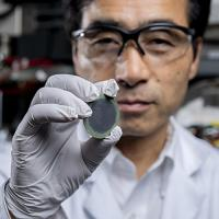 IMat researcher Meilin Liu holds up a low-cost, highly efficient reversible solid oxide cells (H-rSOC) device for hydrogen and electricity generation.